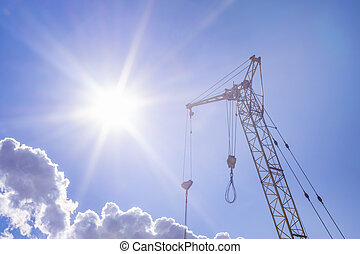 construction crane on a bright Sunny day concept of building and construction of houses