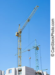 Construction crane on blue sky background