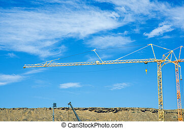 Construction crane on bright summer day