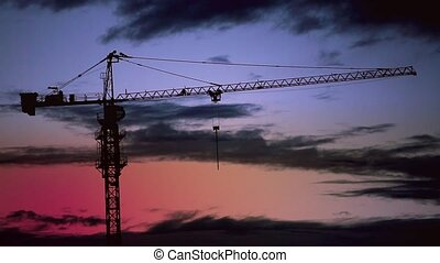 Construction crane on sky background