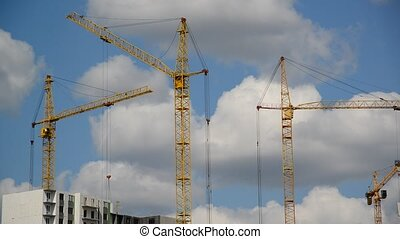 Construction cranes against  sky