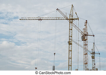 Construction cranes against the sky, new high-rise buildings