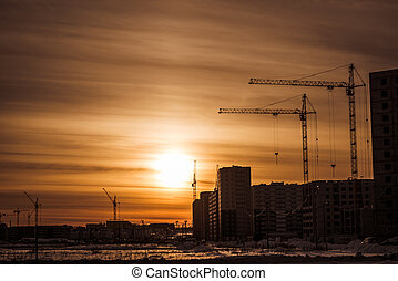 Construction cranes and construction of multi-storey building
