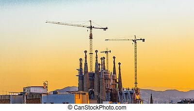 Cranes at Barcelona Church at Dawn
