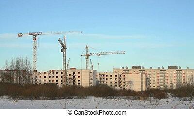 Construction cranes at construction site - Construction...