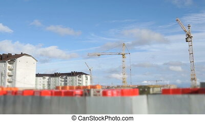 Construction cranes at construction site