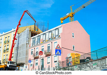 Construction cranes by appartment building - Colorful...