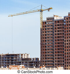Construction, cranes. Tower cranes and modern buildings under construction