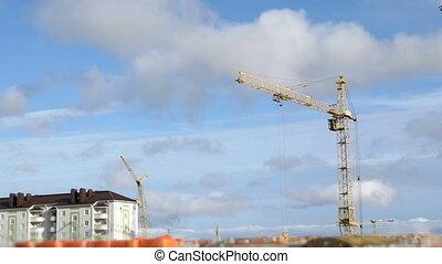 Construction cranes work at construction site