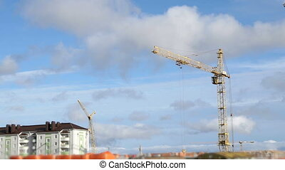 Construction cranes work at construction site