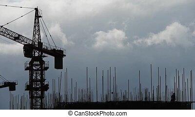 Construction-cranes,clouds cover
