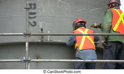 construction crew - footage of construction crew working on...