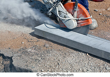 Construction works with circular abrasive cutoff saw angle grinding machine and dust