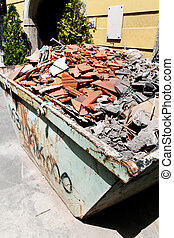 Construction debris at a construction site - A container...