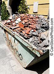Construction debris at a construction site - A container...