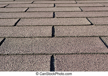 Construction: Detail of shingles on house rooftop.