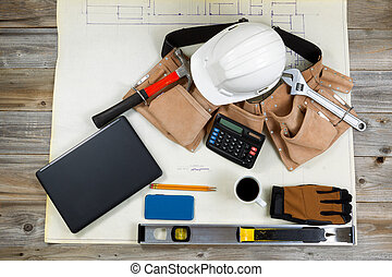 Construction drawing blue print with basic tools on top -...