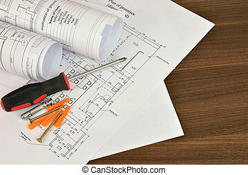 Construction drawings, screwdriver and screws