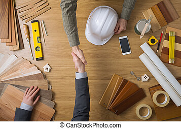 Construction engineer and businessman shaking hands