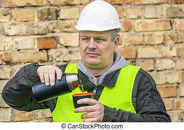 Construction Engineer drinking tea