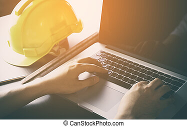 Construction Engineer is working with computer in office