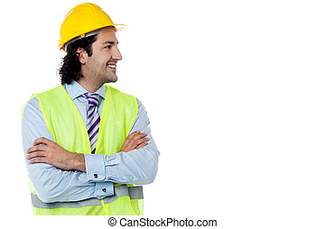 Construction engineer smiling confidently