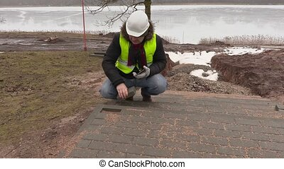 Construction engineer take pictures of pavement