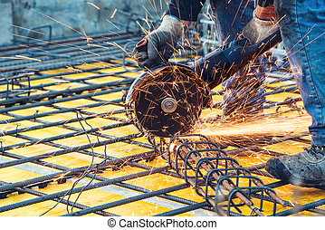 construction engineer using a circular saw cutting reinforced steel and bars