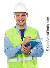 Construction engineer writing on notepad