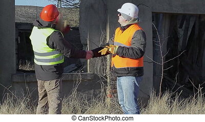 Construction engineers talking near