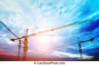 construction equipment and elements of a building under construction at Sunset
