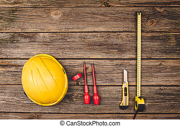 Construction equipment and tools on wooden table top view