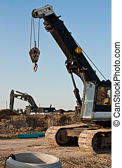 Construction Equipment at a Building Site - A mobile crane...
