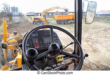 Cabine of a grader at construction site