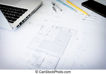 Construction equipment. Repair work. Drawings for building Architectural project, blueprint rolls and divider compass on table. Engineering tools concept. Copy space