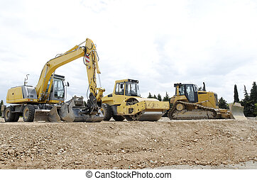 construction equipment, three industrial vehicles