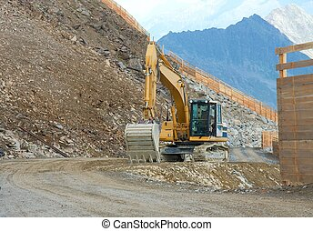 Construction - Excavator machine on a construction site in ...