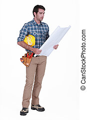 Construction foreman looking at a blueprint