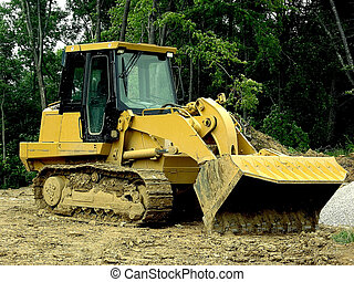 Construction - Front Loader *** A front loader sits in the muddy clay at a new home community construction site in Northern Kentucky, USA.