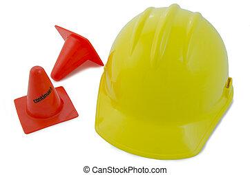 Construction helmet and cones - Yellow construction helmet...