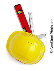 close up of a yellow construction helmet, ruler and level on white background with clipping path