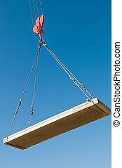 hoisting a concrete slab with crane using metal slings