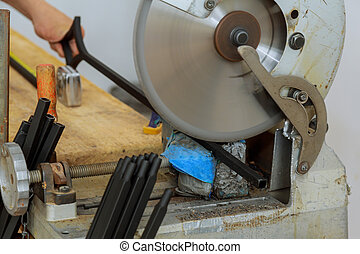Construction industry worker with electro saw cutting and installing metal railings