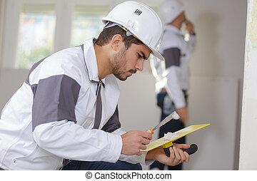 construction industry worker with tools plastering walls