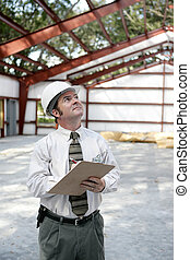 Construction Inspector - Copyspace - A vertical view of a...