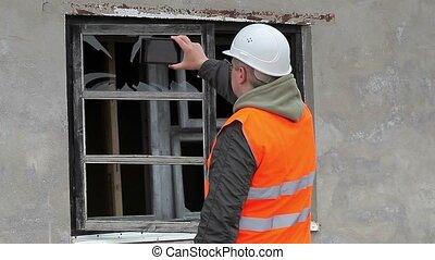 Construction inspector filmed broken window