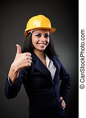 Construction lady thumbs up