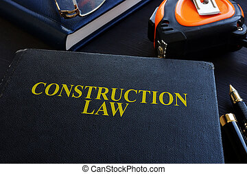 Construction law. Book and glasses on a wood.