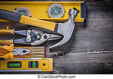 Construction level wooden meter pliers tin snips hammer horizontal version.
