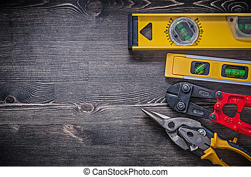 Construction levels steel cutter tin snips copy space.